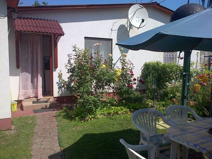 House in Siófok, Hungary. Darling cottage, totally equipped for 2-3 adults or family with 2 children 50  m. from public beach on the south (shallow) side of Lake Balaton. Siofok 5km Budapest 100 excursions: Adventure Park, fishing, disco, restaurants.Train access. - Get $25 credit with Airbnb if you sign up with this link http://www.airbnb.com/c/groberts22