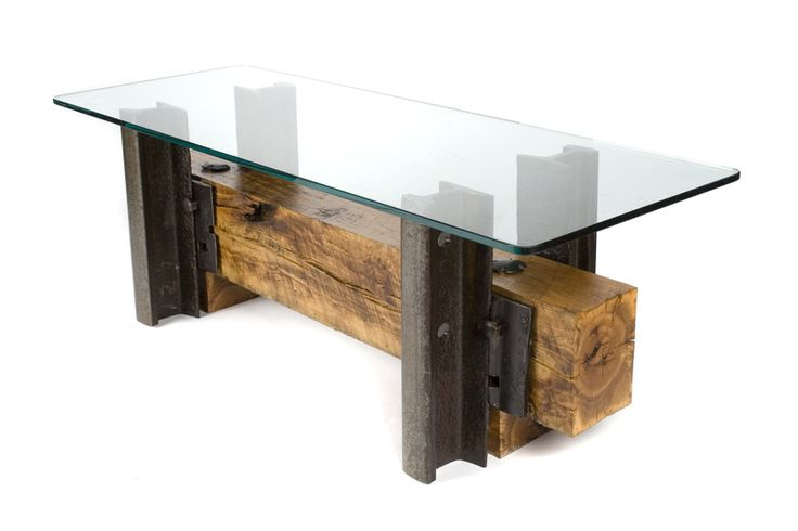 "The Double Track Coffee Table features TCI rail from 1908. Crafted from a single piece of rescued cherry crosstie, this piece has a beautiful grain and unique features. It is finished with only a clear coat of polyurethane sealer to bring out the natural colors. The top is 1/2"" thick glass with penciled edges. This piece is individually numbered with a salvaged railroad tie date nail from 1911."