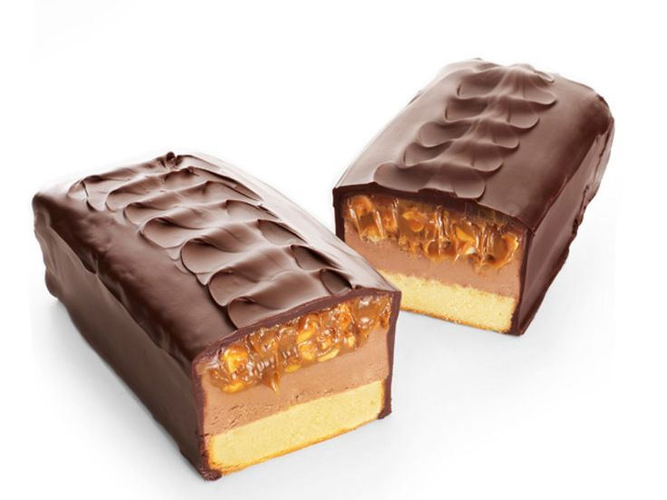 Candy Bar Cake : If there's one problem with candy bars, it's that they're never quite big enough. This cake should do the trick: Top store-bought pound cake with chocolate buttercream and dulce de leche mixed with roasted peanuts to create the look of chewy nougat and gooey peanut-caramel filling.