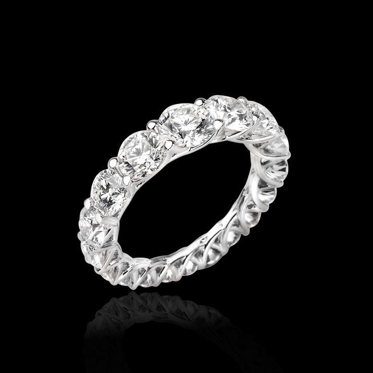 Crossed set eternity ring with graduated white diamonds. #lentivillasco #diamonds #ring #jewelry