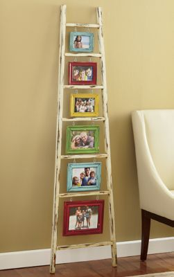 Inspiration for displaying art/photos/memories. Use same coloured frames but hanging items like shells or a crocheted dreamcatcher. Display ladder.