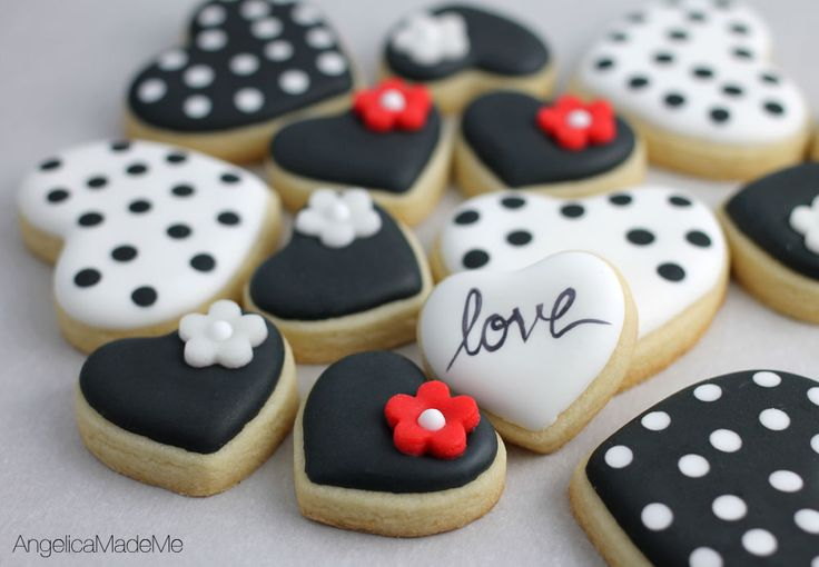 Black, white and red heart sugar cookies. Cute medium sized cookies with black and white polka dots. Plus, mini black hearts topped with marshmallow fondant flowers.