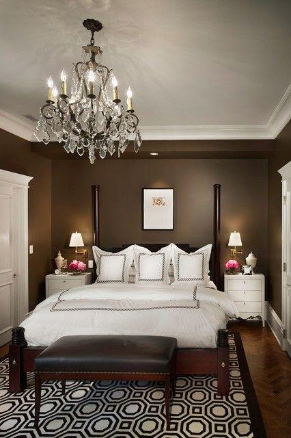 bedrooms - chocolate brown walls bronze chandelier poster bed white nightstands hotel shams duvet bedding brown leather bench nailhead trim bronze chandelier brass sconces