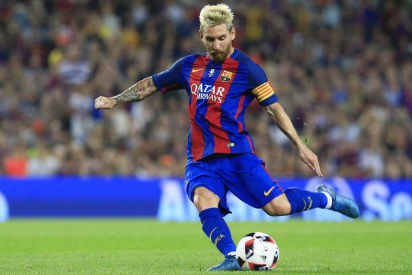Barcelona's Argentinian forward Lionel Messi kicks a ball during the second leg…