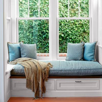 """window seat with storage drawers below and a ledge --- links to a This Old House article titled, """"All About Window Seats"""""""