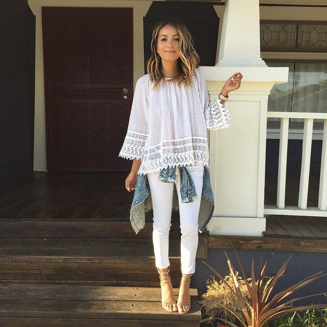 white lace blouse + white skinny jeans + nude ankle-strap heels + denim jacket tied around the waist