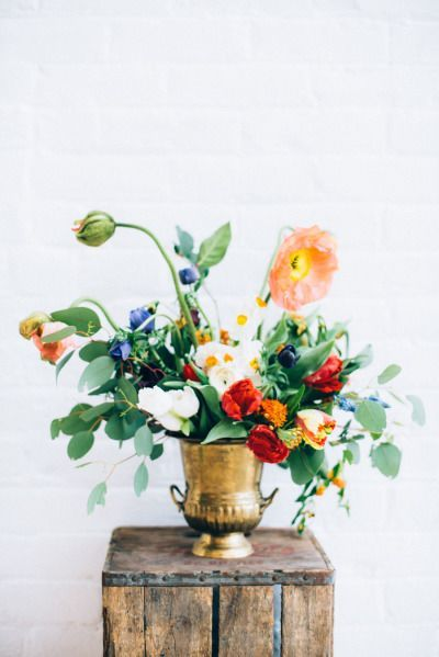 Gold vase and bold colors: http://www.stylemepretty.com/living/2015/04/09/how-to-dutch-inspired-floral-arrangements/ | Photography: Cambria Grace - http://www.cambriagrace.com/