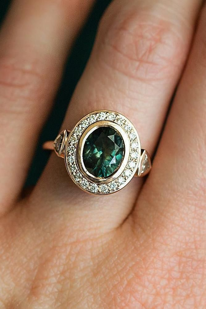 engagement ring trends vintage oval cut halo gold