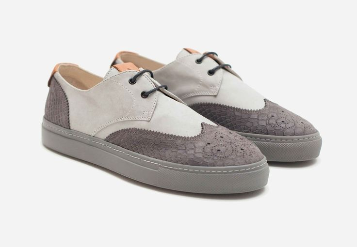 Avvikk - Nico Stone  Lace up sneakers with classic brogue design elements. Crafted from smooth leather complemented by embossed snake effect, built on hard- wearing rubber sole.