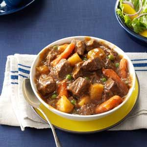 Slow Cooker Beef Vegetable Stew Recipe -Come home to warm comfort food! This is based on my mom's wonderful recipe, though I tweaked it for the slow cooker. Add a sprinkle of Parmesan to each bowl for a nice finishing touch. —Marcella West, Washburn, Illinois