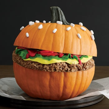 "Photo:       « previous 4 of 5 next »    BUILD A BURGER     Make a big batch of Cocoa Krispies Treats and mold it into a burger patty while still warm. Top it with rolled-out green Fruit Roll-Ups, yellow Laffy Taffy, strawberry Sour Punch Bites and red cookie icing. To make the bun, cut a pumpkin in half, scoop out the seeds and ""glue"" white Good & Plenty candies to the top half of the pumpkin using white cookie icing."