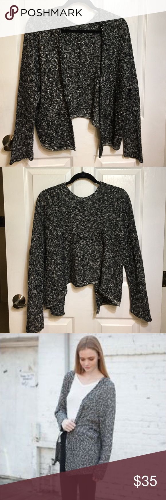 Brandy Melville Cardigan Black and white cardigan bought at Brandy Melville 💗 In perfect condition! The sizing is 'one size fits all' but fits like a medium :) Brandy Melville Sweaters Cardigans