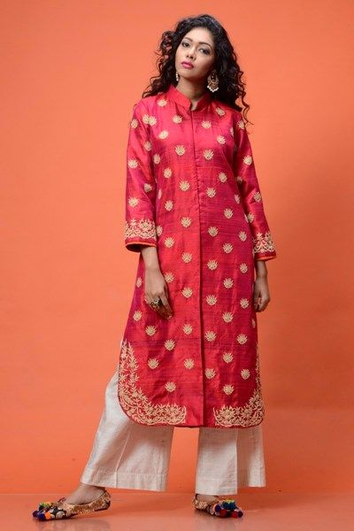 This Classy magenta raw silk jacket with beige embroidery all over teamed up with white pants redefines the deep rooted notion of 'simple being beautiful'