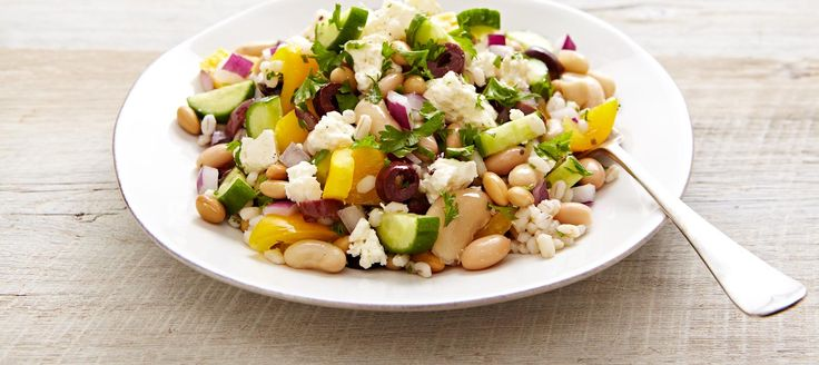 Adding beans and grain to a classic Greek salad turns it into a hearty one-dish meal that includes all the fresh flavour of Canadian Feta.