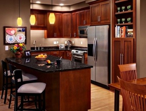 Cherry Rockford kitchen cabinets from CliqStudios paired with stainless steel hardware and appliances.