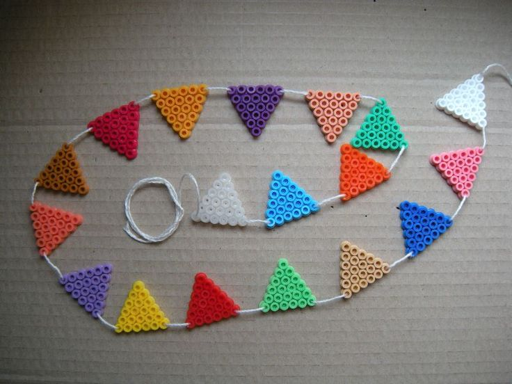 Hama beads garland by SuperCrea ~ these look a lot like perler beads.....great idea for older kids that can use an iron