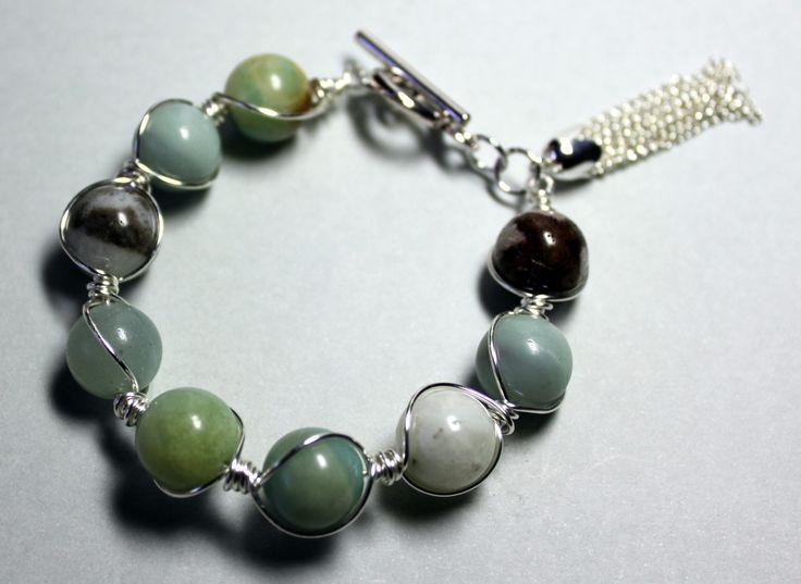 This elegant bracelet is made up of 12mm amazonite round beads linked together using Artistic Wire®. Length – 22cm.  $38  www.preciouzpiecez.com.au