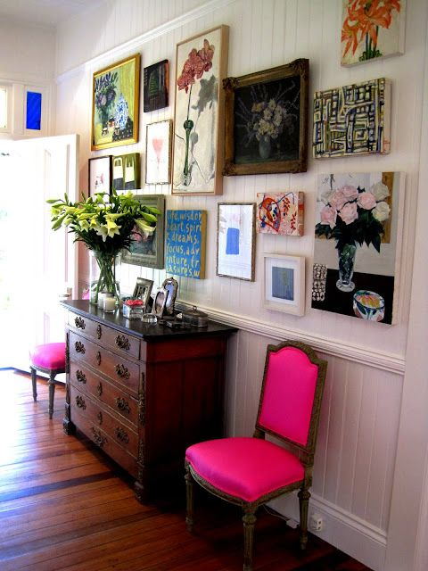Pick a small wall and fill it full of artwork. Then add a grounding punch with bold upholstery and heirloom furniture. - Rebecca Rebouche