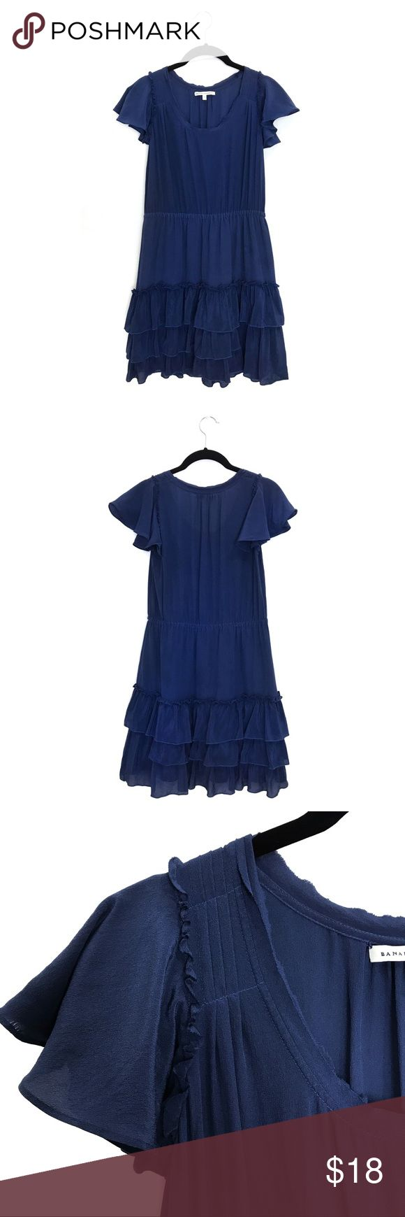{Banana Republic} Navy Silk Dress, Small This feminine, raw silk dress features pleats & a ruffle trim at the shoulder, a tiered bottom hem, & an elasticized waist.  The skirt is lined, bust is unlined. The material tag and care instructions are missing. It is in VGUC, with one flaw: There is a white spot on the skirt. I believe it was caused by hard water deposits in my steamer; it did not come out when I hand washed it in cold water with Woolite. All measurements taken laying flat and are…