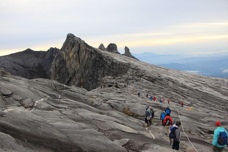 Descending across the granite face of Mount Kinabalu