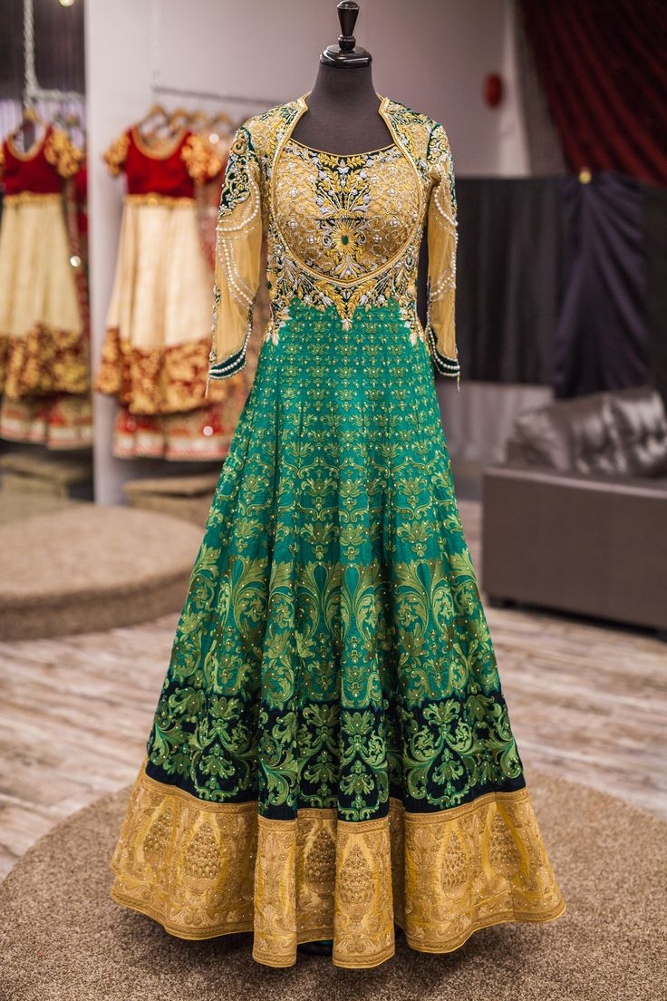 This exquisite jewel toned emerald green anarkali is a complete gem and the colour blocking effect makes this piece one of a kind!