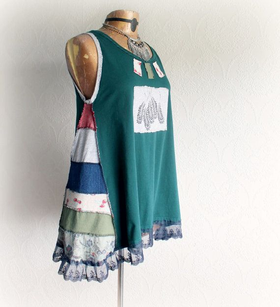Womens, upcycled, reconstructed, teal green, patchwork, boho tank top in size large/XL. One-Of-A-Kind, Eco-Friendly, Handmade Clothing for Women, Plus Size Women and Children. SIENNA Tank top This one of a kind top is made from cotton knit fabric and features patchwork panels on the sides, a lacy ruffle around the bottom and a stencil painted accent patch on the front. Womens size Large/XL Bust: will fit 38-41 inches (96-104 cm) Waist: free Length from top of shoulder to bottom ed...