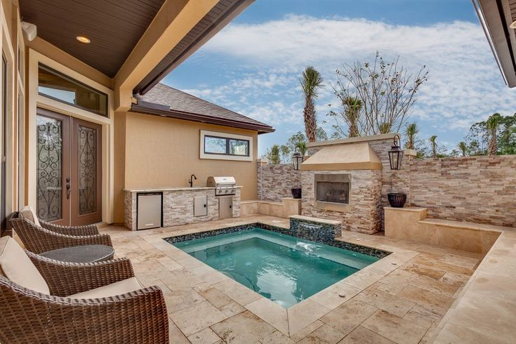 jacksonville swimming pools for small with stainless steel grate pool mediterranean and water fountain outdoor kitchen