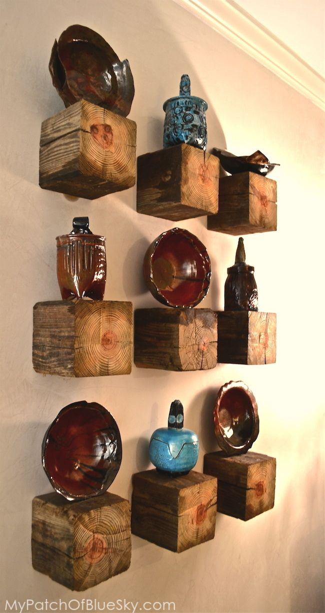 Turn a salvaged garden post into shelving from My Patch of Blue Sky ~ North Carolina pottery on rustic wood displays.