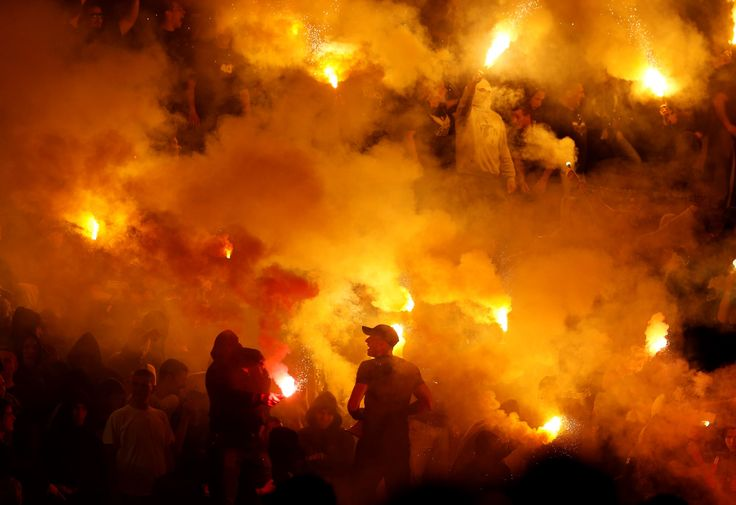 Partizan soccer fans light torches during a Serbian National soccer league derby match between Red Star and Partizan in Belgrade, Serbia, on April 25, 2015. Thousands of riot policemen were deployed throughout Belgrade to prevent possible violence during the derby match between the two bitter rivals.