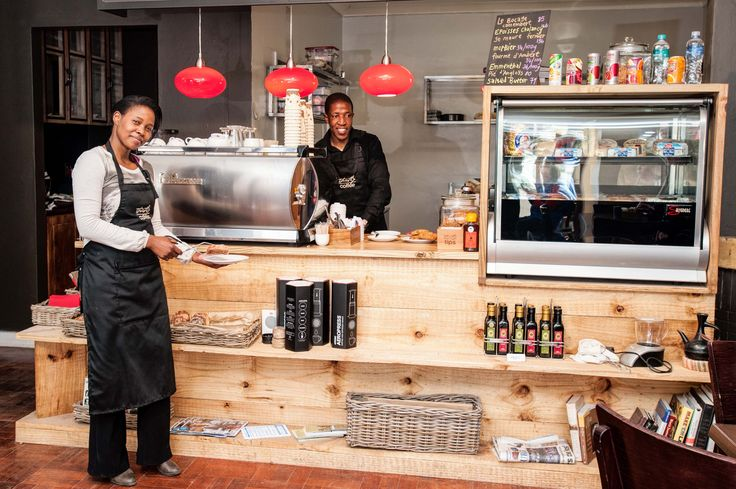 Thembi and Jafta ready to serve food and coffee.