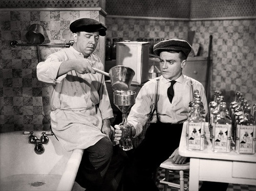 James Cagney and Frank McHugh mixing up a batch of bathtub gin in The Roaring Twenties (1939).