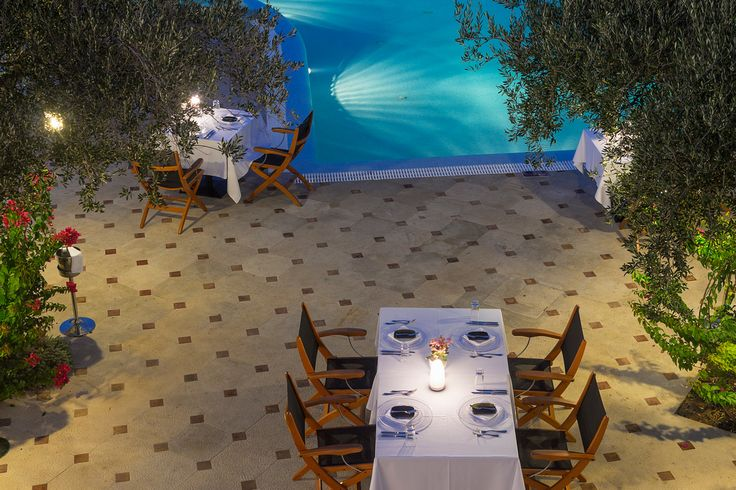 Have a romantic dinner under the stars by the pool at Elounda Gulf Villas and Suites!