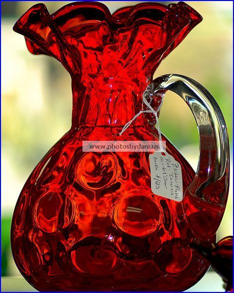 crimson glass pitcher. love the vibrant red - would go perfect with black crystal accessories
