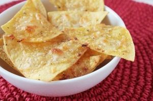 Paleo Tortilla Chips using:  2 cups almond flour  2 medium egg whites  1/2 teaspoon salt  1/2 teaspoon garlic powder  1/2 teaspoon cumin