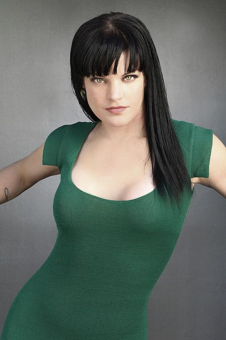 Pauley Perrette is out of character in this form fitting dark green dress. She plays forensic scientist Abby Sciuto of NCIS. I love Abby