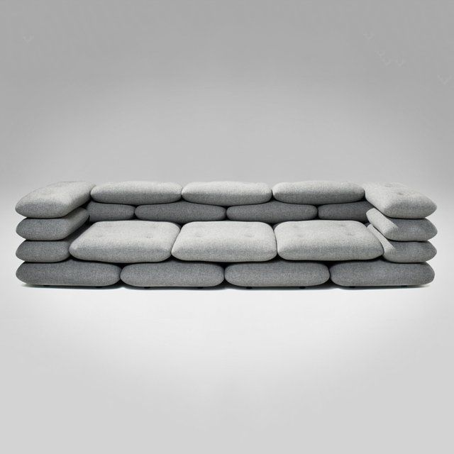 KiBiSi has designed the Brick series for versus. KiBiSi set out to make a sofa with strong architectural references since KiBiSi partner Bjarke Ingels couldn't really find the right architect's sofa for his apartment.  The point of departure was a classic brick bond forming the cushion pattern.  The cushions are tied together and fixed with a tailor quality button. The button, also designed by KiBiSi, is molded of fiber concrete - Yet another architectural reference.