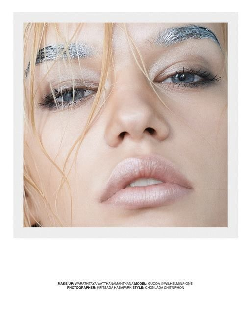 beauty makeup shimmering nude lips blue eyes and silver eyebrows