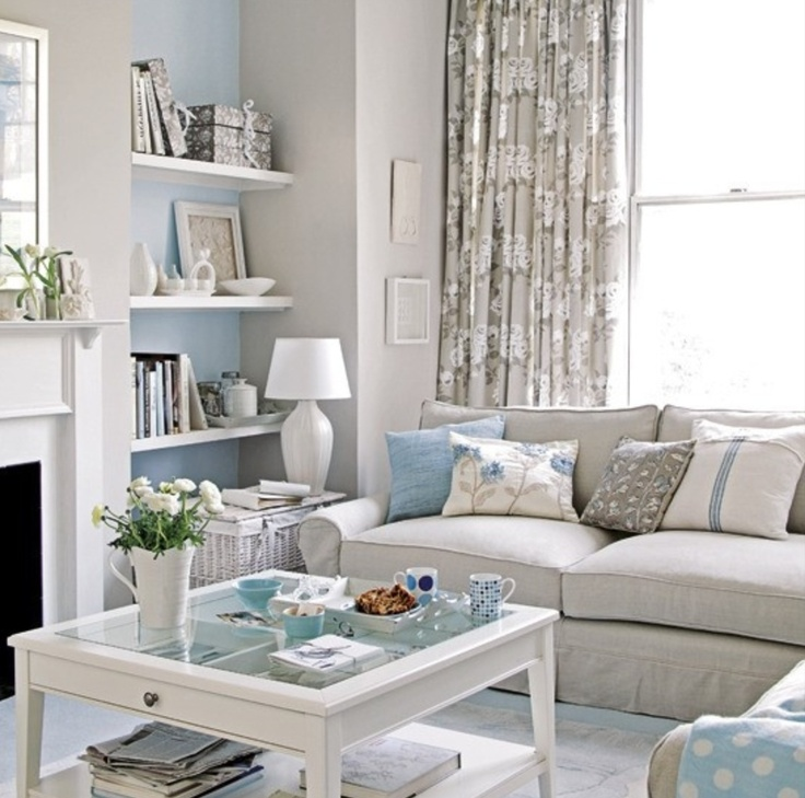 Neutral living room with a touch of blue cozy neutral for Neutral living room ideas