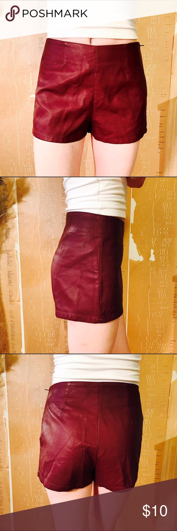 """FOREVER 21 VEGAN FAUX LEATHER MAROON SHORTS #407 FOREVER 21, faux leather short, lined. Burgundy.  CONDITION: EUC No issues.  🎁 SHIPS WITHIN 24HRS  CHEST:  WAIST: 27"""" LENGTH: 11"""" INSEAM: 1.5"""" *All measurements taken while item is laid flat (doubled when necessary) and measured across the front  MATERIAL: Polyester  STRETCH: minimal INSTAGRAM @ORNAMENTALSTONE 🚫Trading Forever 21 Shorts"""
