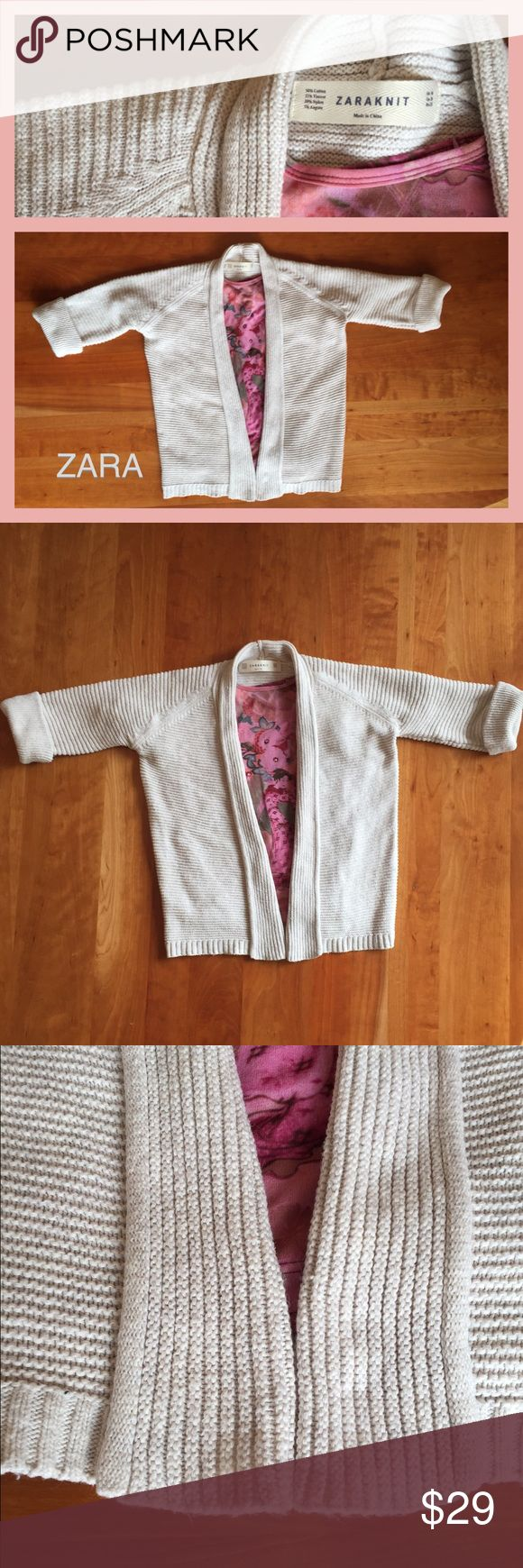 """ZARAKNIT Open Front Cream Cardigan w/  3/4 sleeves Knitted ribbed sweater with 50% Cotton, 25% Viscose, 20% Nylon, 5% Angora yarn. Measurements = Armpit to Armpit laying flat (not stretched) is approximately 20""""....Shoulder to hem approx 21 1/2"""". Gently preloved condition. Gently cold water wash, dry flat. Zara Sweaters Cardigans"""