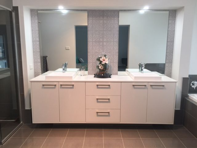 One of our customers, Julie, has shared a photo of the ensuite in her Bronte Farmhouse Grande Manor. Her home is styled with a neutral backdrop and splashes of peacock blue and citrine yellow. For details on this design see http://mcdonaldjoneshomes.com.au/home-designs/new-south-wales-and-queensland/bronte/floorplans. #ensuite #bathroom #hisandhersinks #colour #neutral #neutralbackdrop #citrine #peacock #blue #yellow #acreage #farmhouse #bronte #design