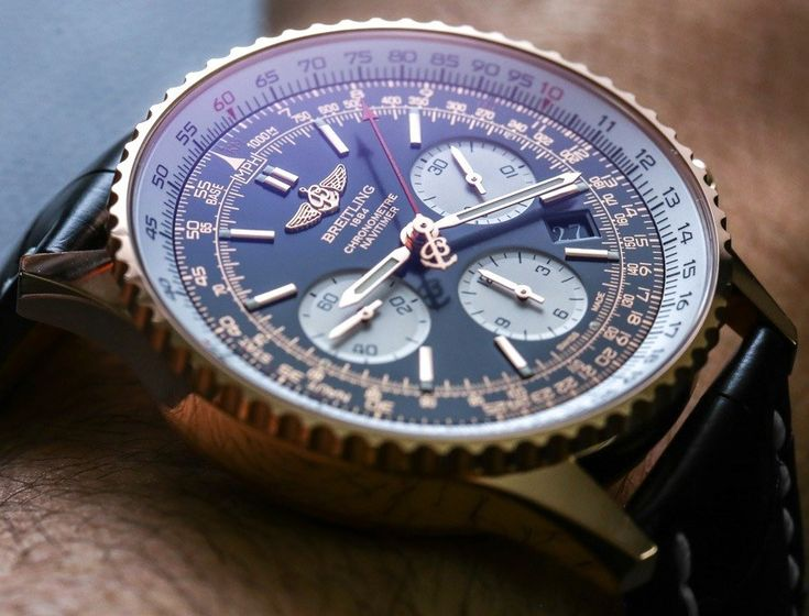 Full wrist-time review & original photos of the Breitling Navitimer 01 watch in gold with price, background, specs, & expert analysis.