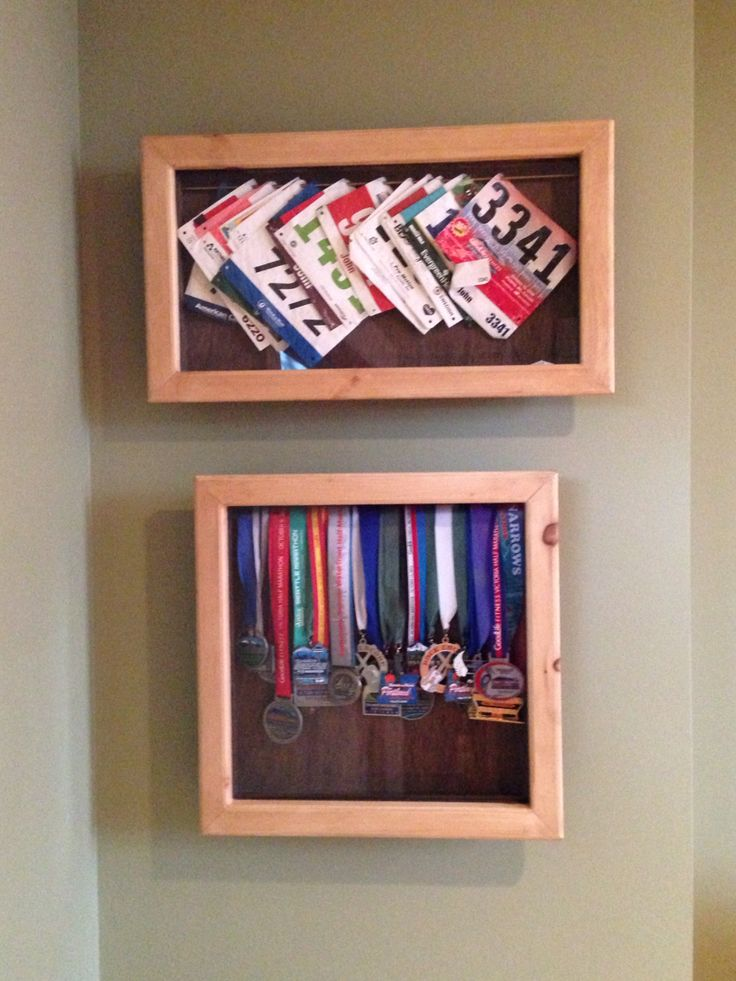 Shadow boxes made by my step son for all of his dad's running hardware.  Running bibs and finisher medal display.