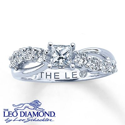 This remarkably brilliant engagement ring for her features a stunning princess-cut Leo Diamond as its centerpiece that has been laser-inscribed with a unique Gemscribe® serial number. Rows of round Leo diamonds sweep across each side for added sparkle. Set in 14K white gold, this fine jewelry ring has a total diamond weight of 1 1/5 carats and is independently certified