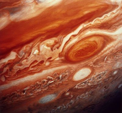 Jupiter's Great Red Spot, which extends from the equator to the southern polar latitudes, as seen by the space probe Voyager 2 in 1979