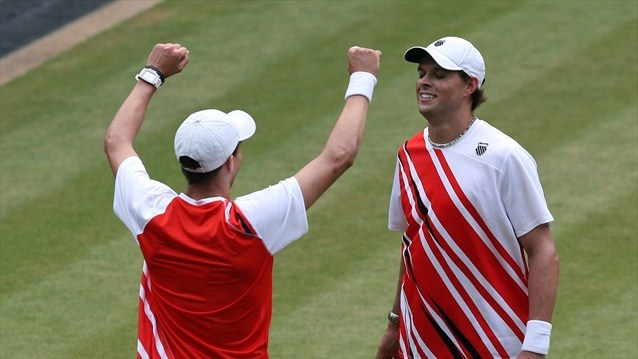 Brothers Mike and Bob Bryan of the United States defeat Jo-Wilfried Tsonga and Michael Llodra of France in their men's Doubles Tennis final on Day 8at Wimbledon