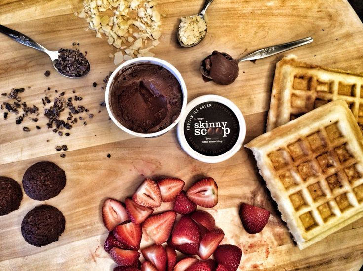 Waffles and ice cream - the healthy version! Gluten free waffles topped with chocolate Skinny Scoop protein ice cream, strawberries, nuts and more! Recipe coming soon!