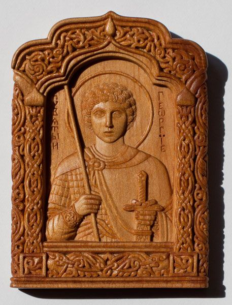 Carved icon miniature Saint George the Victorious 5.8×8.1×0.85 cm; cypress wood, natural linen oil varnish, 2005. Artists are Elena and Sergio Nikolenko.