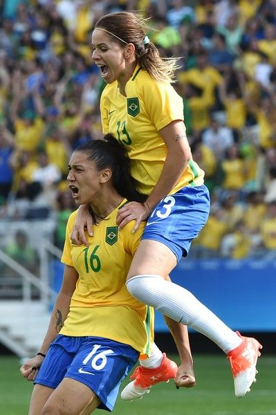 Beatriz (L) of Brazil celebrates her goal against Canada during their Rio 2016 Olympic Games women's bronze medal football match between Brazil vs Canada, at the Arena Corinthians Stadium in Sao Paulo, Brazil on August 19, 2016. / AFP / NELSON ALMEIDA
