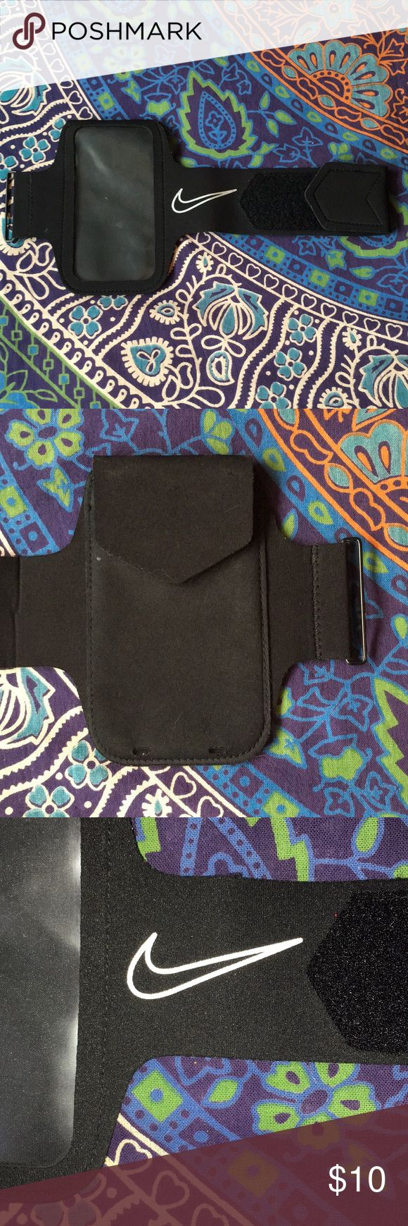Nike running armband Great condition, didn't fit my iPhone 6s but will fit a 6 or 7 or any phone smaller. Reflective detail. Nike Accessories Phone Cases